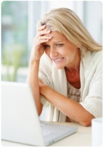 woman-crying-at-computer-282x400